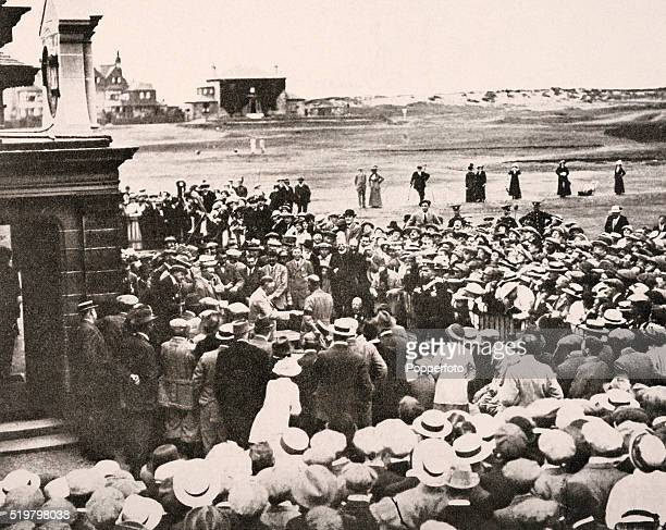 Jersey professional golfer Harry Vardon receives the trophy after winning the British Open Championship for the sixth time at Prestwick circa June...