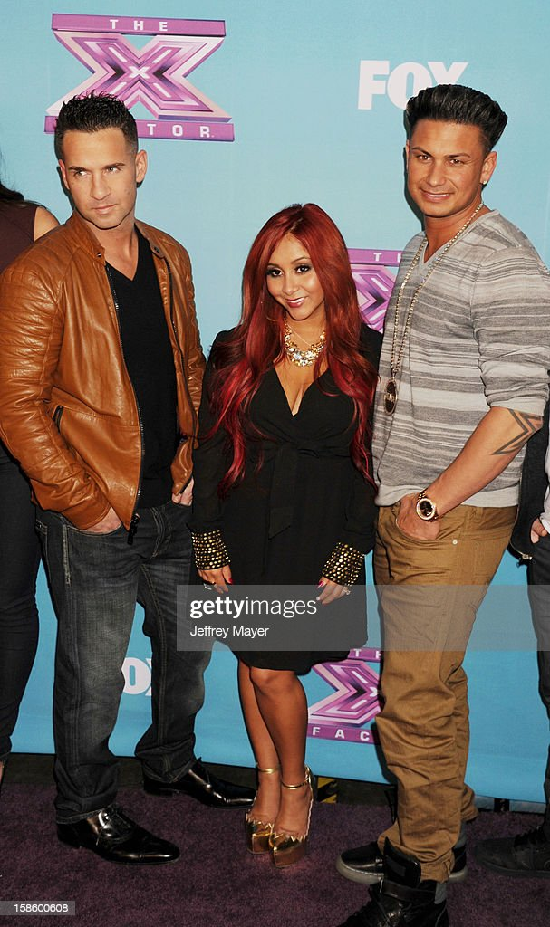 Jersey Shore cast Mike 'The Situation' Sorrentino, Nicole 'Snooki' Polizzi and Paul 'Pauly D' DelVecchio arrive at Fox's 'The X Factor' Season Finale Night 1 at CBS Television City at CBS Studios on December 19, 2012 in Los Angeles, California.