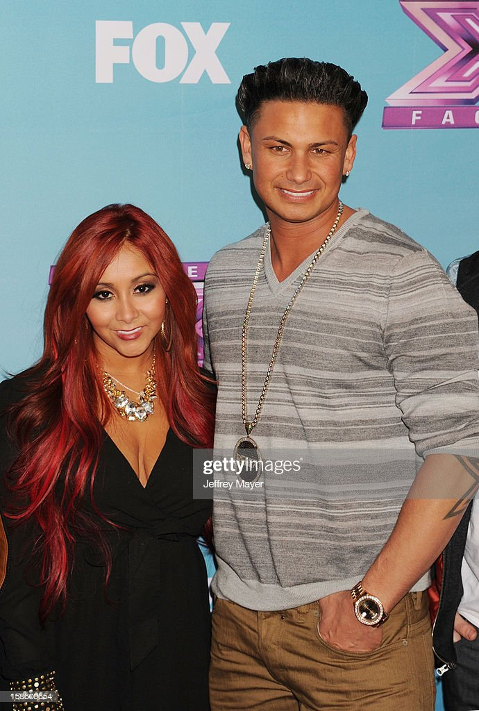 Jersey Shore cast, Nicole 'Snooki' Polizzi and Paul 'Pauly D' DelVecchio arrive at Fox's 'The X Factor' Season Finale Night 1 at CBS Television City at CBS Studios on December 19, 2012 in Los Angeles, California.