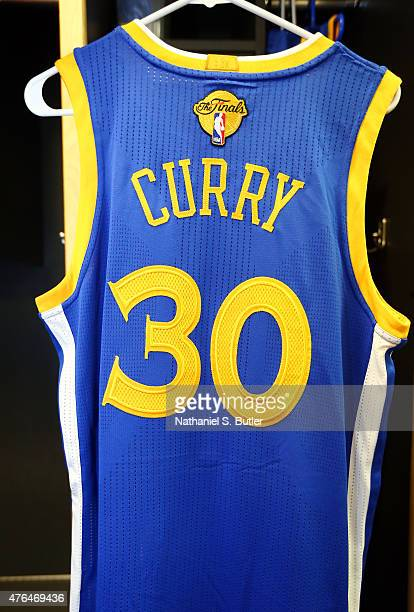 A jersey to be worn by Stephen Curry of the Golden State Warriors hangs in the locker room prior to Game Three of the 2015 NBA Finals at The Quicken...