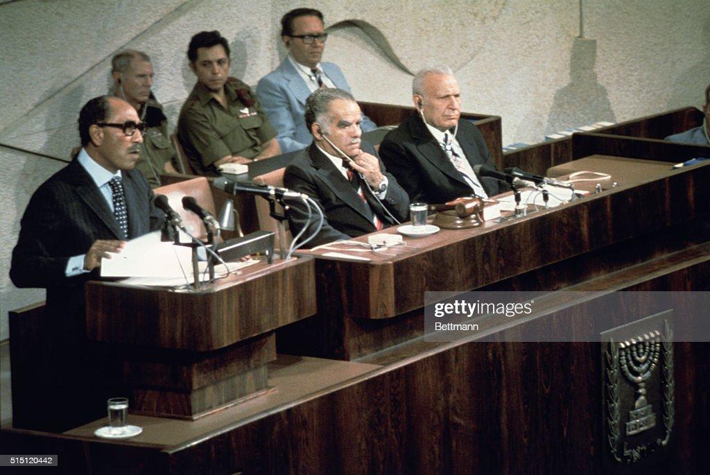 Egypt's President Anwar Sadat speaks to the Israeli parliament. To his left are parliament speaker Yitzhak Shamir and President Ephraim Katzir.