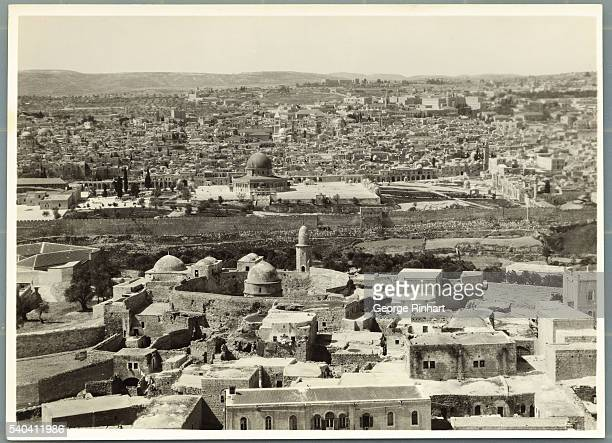Jerusalem is shown from the Mount of Olives In the foreground is the Chapel of the Ascension in which one may see the foot prints supposedly of...