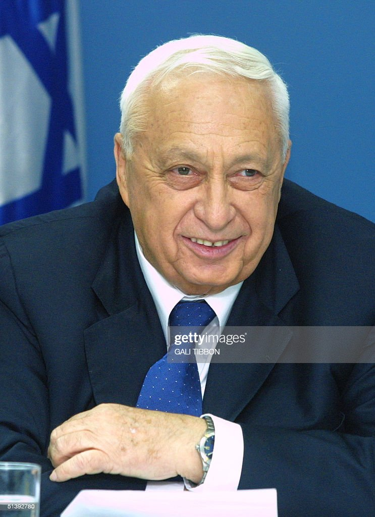 Israeli Prime Minister Ariel Sharon attends 13 August 2001 a meeting with a delegation representing the international federation of Moroccan Jews at...