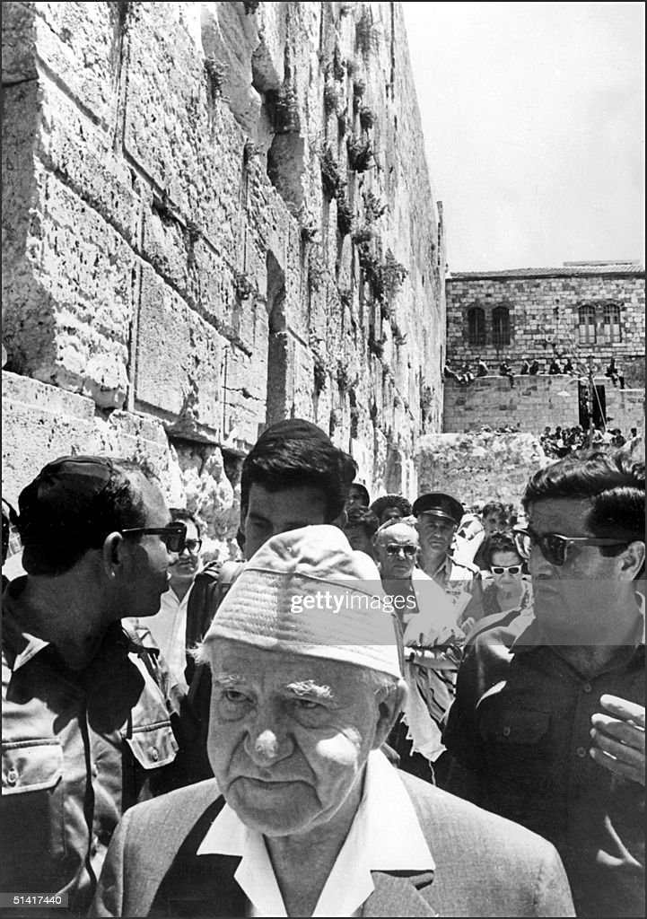 Israeli Prime Minister David BenGurion surrounded by soldiers visits the Wailing Wall 12 June 1967 in Jerusalem after Israeli troops captured the Old...