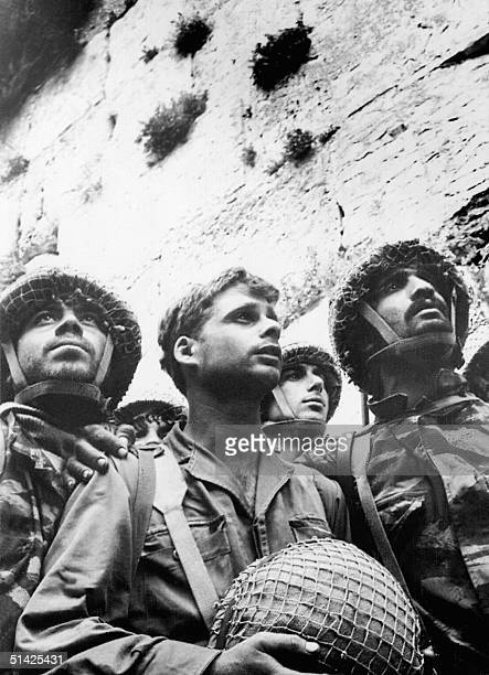 Israeli soldiers celebrate 09 June 1967 in Jerusalem the conquest by Israeli troops over Jordan the Wailing Wall in the eastern part of the Holy City...