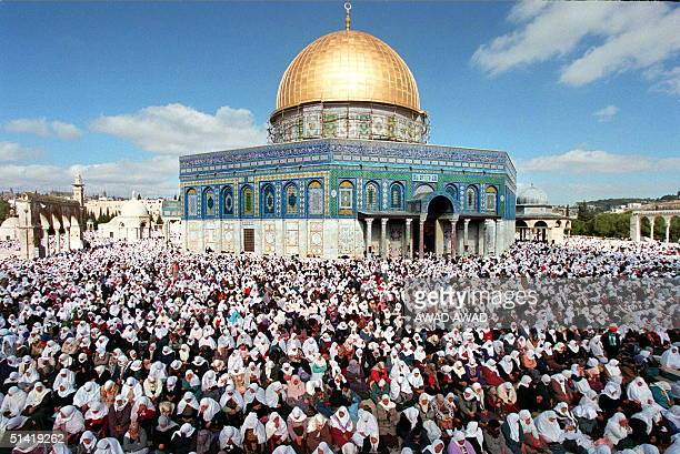 Palestinian women pray in front of the Dome of The Rock as more than 100000 Moslems take part in the first weekly Friday prayers of Ramadan 02...