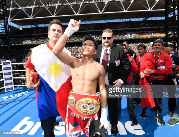 Jerwin Ancajas of the Philippines celebrates beating Teiru Kinoshita of Japan during their IBF World Junior Bantamweight Title fight at Suncorp...