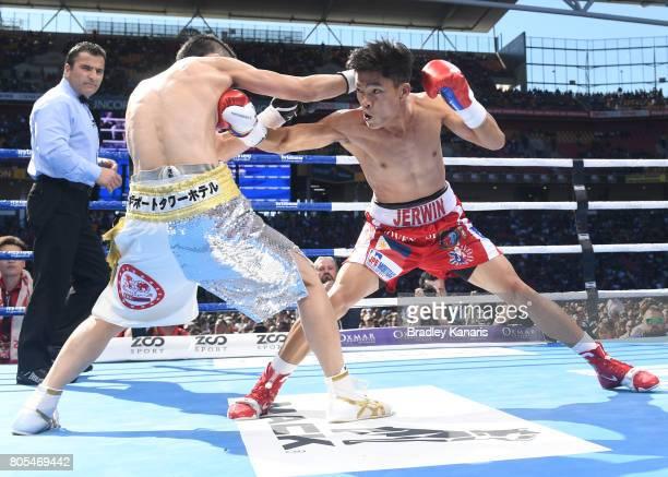 Jerwin Ancajas of the Philippines fights Teiru Kinoshita of Japan during their IBF World Junior Bantamweight Title fight at Suncorp Stadium on July 2...
