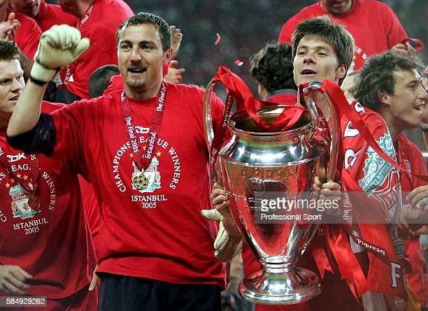 Jerzy Dudek and Xavi Alonso of Liverpool celebrate with the trophy following the UEFA Champions League final between Liverpool and AC Milan on May 25...