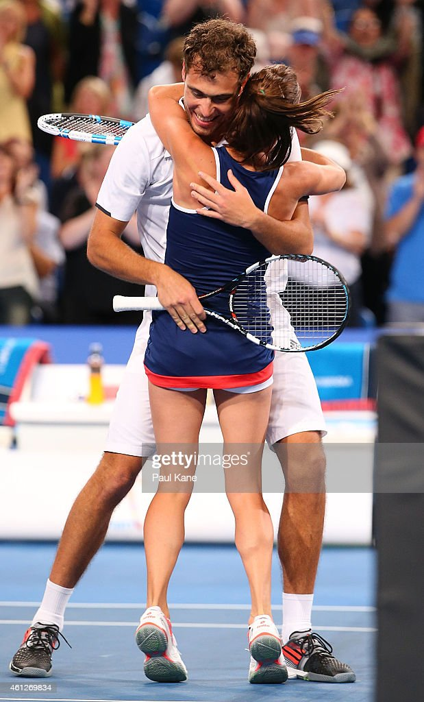 Jerzy Janowicz and Agnieszka Radwanska of Poland celebrate after defeating Serena Williams and John Isner of the United States in the final during...