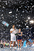 Jerzy Janowicz and Agnieszka Radwanska of Poland pose with the Hopman Cup after defeating Serena Williams and John Isner of the United States in the...