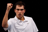 Jerzy Janowicz of Poland celebrates a point against Andy Murray of Great Britain during day 4 of the BNP Paribas Masters at Palais Omnisports de...