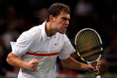 Jerzy Janowicz of Poland celebrates a point against Gilles Simon of France in their Semi Final match on day 6 of the BNP Paribas Masters at Palais...