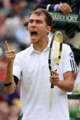 Jerzy Janowicz of Poland celebrates a point during the Gentlemen's Singles quarterfinal match against Lukasz Kubot of Poland on day nine of the...