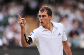 Jerzy Janowicz of Poland celebrates a point during the Gentlemen's Singles semifinal match against Andy Murray of Great Britain on day eleven of the...
