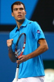 Jerzy Janowicz of Poland celebrates a point in his first round match against Jordan Thompson of Australia during day one of the 2014 Australian Open...