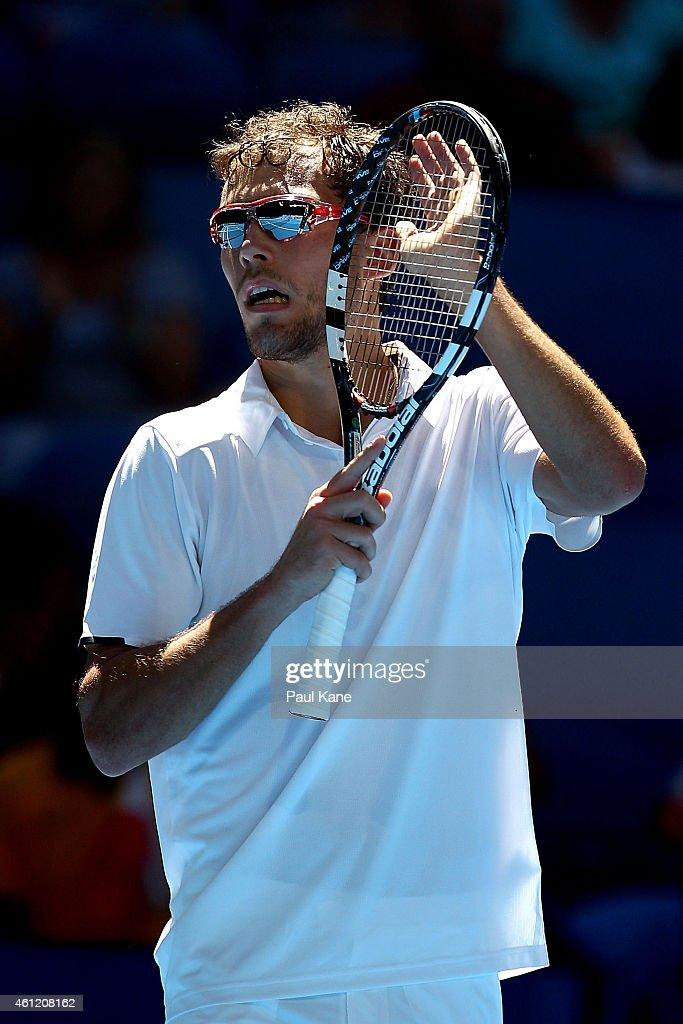 Jerzy Janowicz of Poland celebrates after winning his singles match against Benoit Paire of France during day six of the 2015 Hopman Cup at Perth...