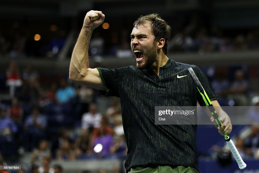 Jerzy Janowicz of Poland celebrates after winning the second set against Novak Djokovic of Serbia & Montenegro during his first round Men's Singles match on Day One of the 2016 US Open at the USTA Billie Jean King National Tennis Center on August 29, 2016 in the Flushing neighborhood of the Queens borough of New York City.