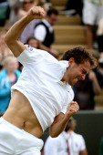 Jerzy Janowicz of Poland celebrates defeating Lleyton Hewitt of Australia in their Gentlemen's Singles second round match on day five of the...
