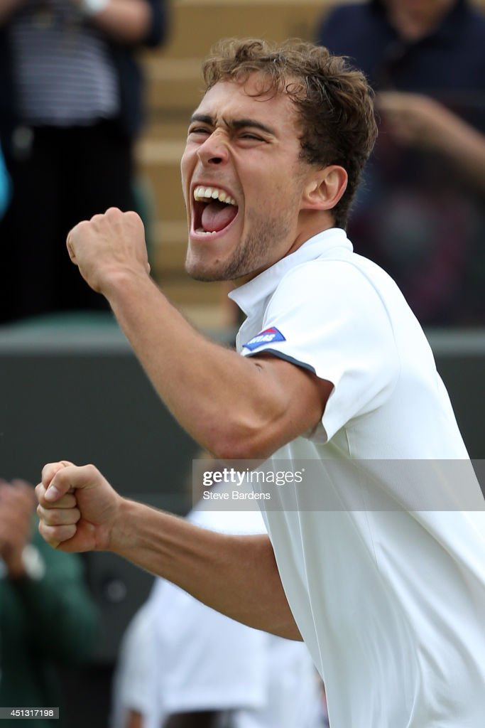 Jerzy Janowicz of Poland celebrates defeating Lleyton Hewitt of Australia in their Gentlemen's Singles second round match on day five of the Wimbledon Lawn Tennis Championships at the All England Lawn Tennis and Croquet Club on June 27, 2014 in London, England.