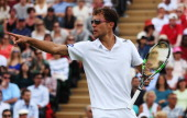Jerzy Janowicz of Poland celebrates during his Gentlemen's Singles second round match against Lleyton Hewitt of Australia on day five of the...