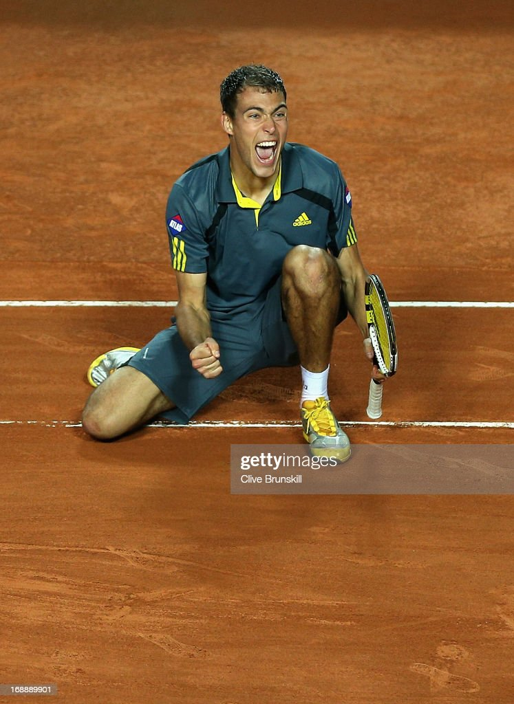 <a gi-track='captionPersonalityLinkClicked' href=/galleries/search?phrase=Jerzy+Janowicz&family=editorial&specificpeople=4482863 ng-click='$event.stopPropagation()'>Jerzy Janowicz</a> of Poland celebrates match point against Richard Gasquet of France in their third round match during day five of the Internazionali BNL d'Italia 2013 at the Foro Italico Tennis Centre on May 16, 2013 in Rome, Italy.