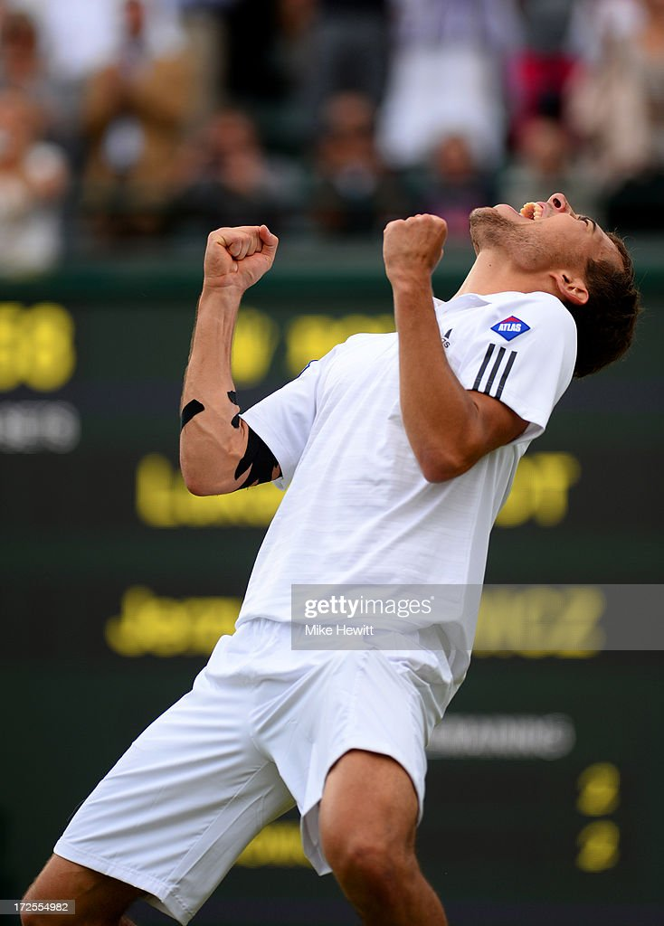 Jerzy Janowicz of Poland celebrates match point during the Gentlemen's Singles quarterfinal match against Lukasz Kubot of Poland on day nine of the...