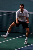 Jerzy Janowicz of Poland celebrates victory against Gilles Simon of France in their Semi Final match on day 6 of the BNP Paribas Masters at Palais...