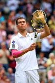 Jerzy Janowicz of Poland celebrates victory during the Gentlemen's Singles third round match against Nicolas Almagro of Spain on day five of the...