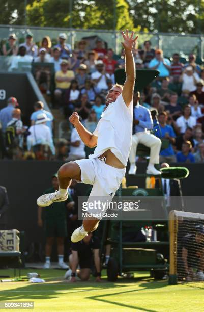 Jerzy Janowicz of Poland celebrates victory during the Gentlemen's Singles second round match against Lucas Pouille of France on day three of the...
