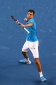 Jerzy Janowicz of Poland celebrates winning his first round match against Jordan Thompson of Australia during day one of the 2014 Australian Open at...