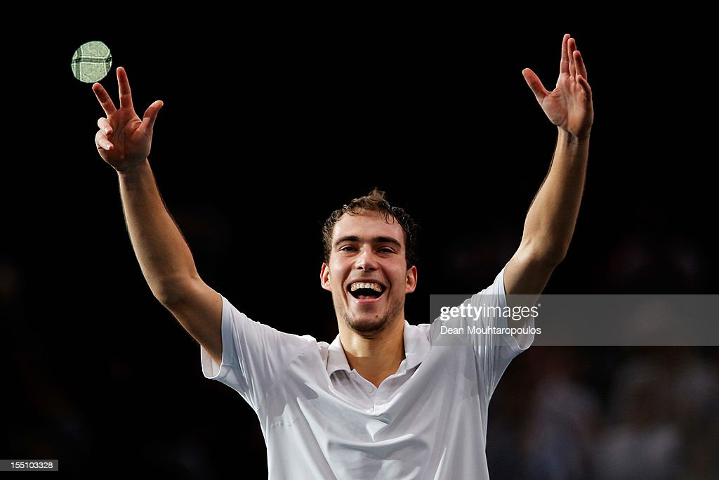 Jerzy Janowicz of Poland celebrates winning the match against Andy Murray of Great Britain during day 4 of the BNP Paribas Masters at Palais...