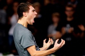 Jerzy Janowicz of Poland celebrates winning the match against Janko Tipsarevic of Serbia in t#he Quarter Finals on day 5 of the BNP Paribas Masters...