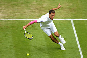 Jerzy Janowicz of Poland hits a backhand during the Gentlemen's Singles third round match against Nicolas Almagro of Spain on day five of the...