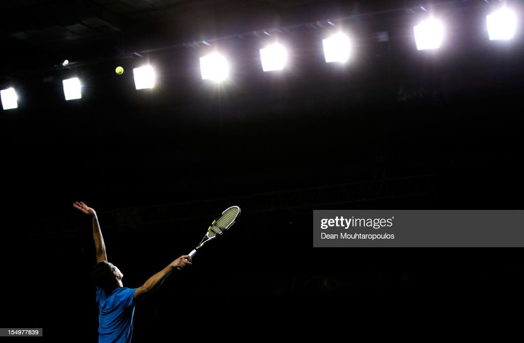 <a gi-track='captionPersonalityLinkClicked' href=/galleries/search?phrase=Jerzy+Janowicz&family=editorial&specificpeople=4482863 ng-click='$event.stopPropagation()'>Jerzy Janowicz</a> of Poland in action against Philipp Kohlschreiber of Germany during day 1 of the BNP Paribas Masters at Palais Omnisports de Bercy on October 29, 2012 in Paris, France.