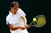 Jerzy Janowicz of Poland in action during his Gentlemen's Singles first round match against Somdev Devvarman of India on day two of the Wimbledon...