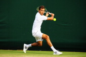 Jerzy Janowicz of Poland in action during his Gentlemen's Singles third round match against Tommy Robredo of Spain on day six of the Wimbledon Lawn...