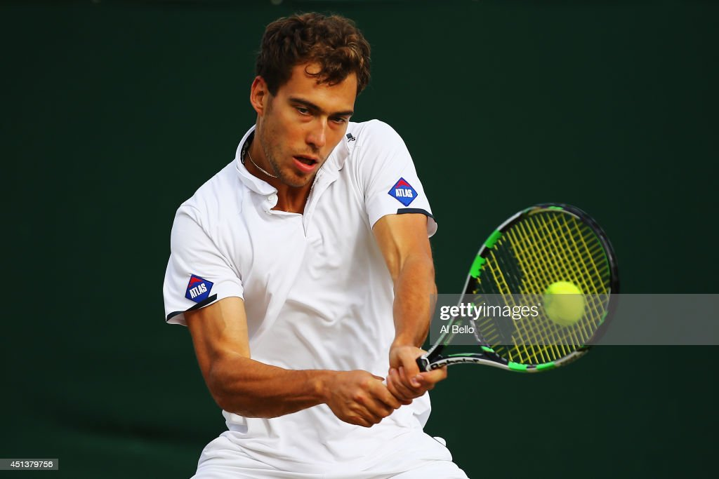 Jerzy Janowicz of Poland in action during his Gentlemen's Singles third round match against Tommy Robredo of Spain on day six of the Wimbledon Lawn Tennis Championships at the All England Lawn Tennis and Croquet Club at Wimbledon on June 28, 2014 in London, England.