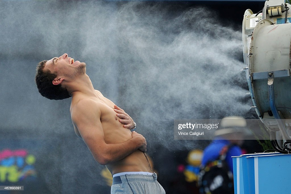 Jerzy Janowicz of Poland in front of fan coolers at Grand Slam Oval during day 4 of the 2014 Australian Open at Melbourne Park on January 16, 2014 in Melbourne, Australia.