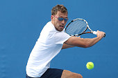 Jerzy Janowicz of Poland plays a backhand in his first round match against Hiroki Moriya of Japan during day two of the 2015 Australian Open at...