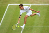 Jerzy Janowicz of Poland plays a forehand during the Gentlemen's Singles quarterfinal match against Lukasz Kubot of Poland on day nine of the...