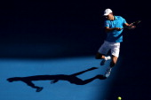 Jerzy Janowicz of Poland plays a forehand in his first round match against Jordan Thompson of Australia during day one of the 2014 Australian Open at...