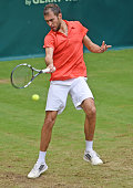 Jerzy Janowicz of Poland plays a forehand in his match against Kei Nishikori of Japan during day five of the Gerry Weber Open at Gerry Weber Stadium...