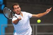 Jerzy Janowicz of Poland plays a forehand in his second round match against Gael Monfils of France during day four of the 2015 Australian Open at...