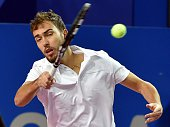 Jerzy Janowicz of Poland plays a return to Richard Gasquet of France during their final tennis match at the Open Sud de France world tour ATP...