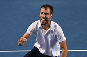 Jerzy Janowicz of Poland reacts after beating Gael Monfils of France in their men's singles match on day four of the 2015 Australian Open tennis...