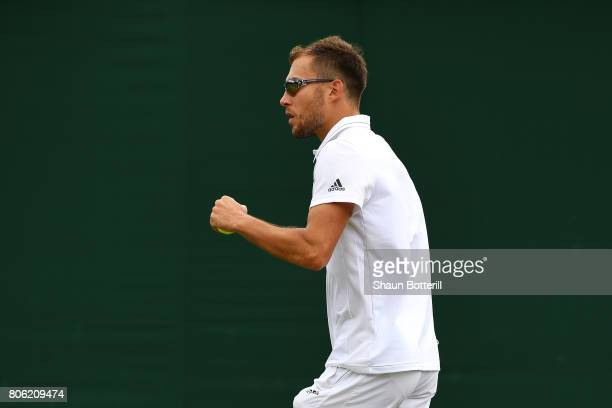Jerzy Janowicz of Poland reacts during the Gentlemen's Singles first round match against Denis Shapovalov of Canada on day one of the Wimbledon Lawn...