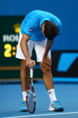 Jerzy Janowicz of Poland reacts in his first round match against Jordan Thompson of Australia during day one of the 2014 Australian Open at Melbourne...