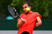 Jerzy Janowicz of Poland returns a shot during his men's singles match against Leonardo Mayer of Argentina on day five of the 2015 French Open at...