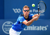Jerzy Janowicz of Poland returns a shot from Kevin Anderson of South Africa during the third day of the WinstonSalem Open at Wake Forest University...